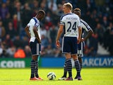Dejected Brown Ideye, Darren Fletcher and Saido Berahino of West Brom after conceding the third goal during the Barclays Premier league match West Bromwich Albion and Queens Park Rangers at The Hawthorns on April 4, 2015