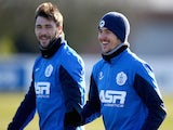 Charlie Austin (L) and Joey Barton in action during a Queens Park Rangers training session at the Harlington Sports Ground on February 6, 2015