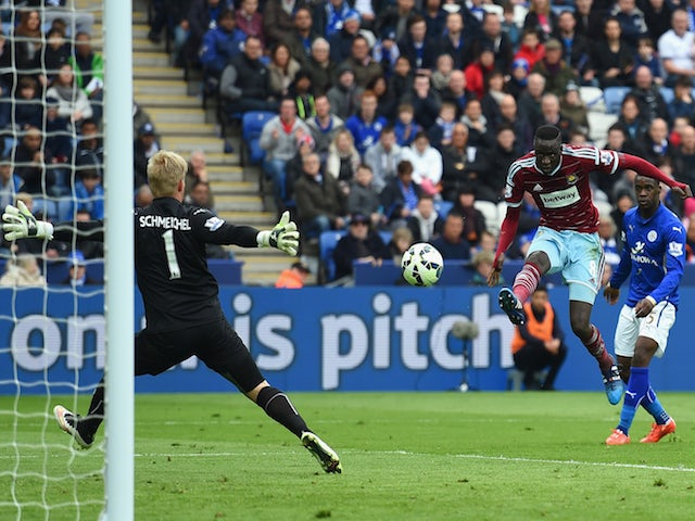 Cheikhou Kouyate of West Ham scores their first goal past Kasper Schmeichel of Leicester City during the Barclays Premier league match Leicester City and West Ham United at The King Power Stadium on April 4, 2015