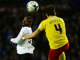 Darren Bent of Derby and Gabriele Angella of Watford battle for an aerial ball during the Sky Bet Championship match between Derby County and Watford at iPro Stadium on April 3, 2015