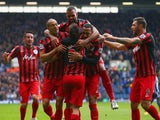 Eduardo Vargas of QPR (C) is congratulated by team mates on scoring the opening goal during the Barclays Premier league match West Bromwich Albion and Queens Park Rangers at The Hawthorns on April 4, 2015