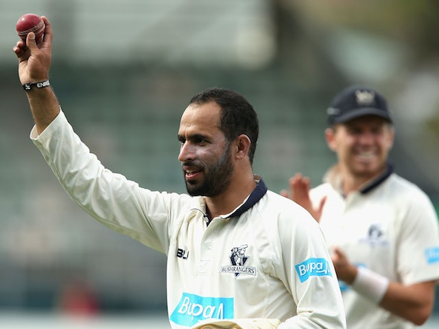 Fawad Ahmed of Victoria walks off holding the ball up high after taking eight wickets during day two of the Sheffield Shield final match between Victoria and Western Australia at Blundstone Arena on March 22, 2015