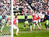 Ramon Leeuwin #3 of Utrecht can only watch as the ball comes off him to score an own goal during the Dutch Eredivisie match between FC Utrecht and Ajax Amsterdam held at Stadion Galgenwaard on April 5, 2015