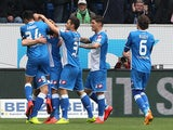 Hoffenheim's striker Sven Schipplock (covered) celebrates scoring the 1-0 with teammates during the German first division Bundesliga football match 1899 Hoffenheim vs Borussia Moenchengladbach in Sinsheim, southern Germany, on April 4, 2015