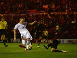 James Ward-Prowse of England scores their third goal under pressure from Julian Korb of Germany during the international friendly between England Under 21 and Germany Under 21 at Riverside Stadium on March 30, 2015