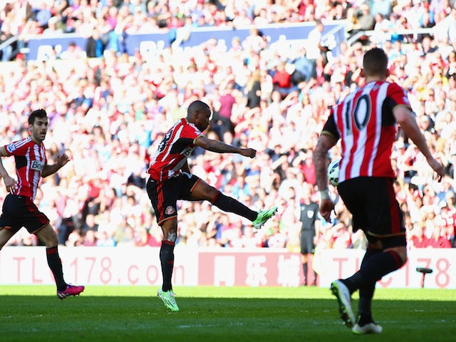 Jermain Defoe of Sunderland scores the opening goal during the Barclays Premier League match between Sunderland and Newcastle United at Stadium of Light on April 5, 2015