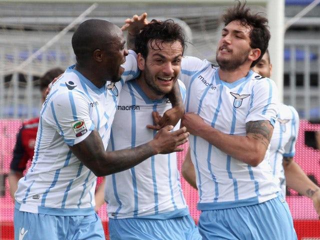 Marco Parolo of Lazio celebrated the goal of 1-3 during the Serie A match between Cagliari Calcio and SS Lazio at Stadio Sant'Elia on April 4, 2015