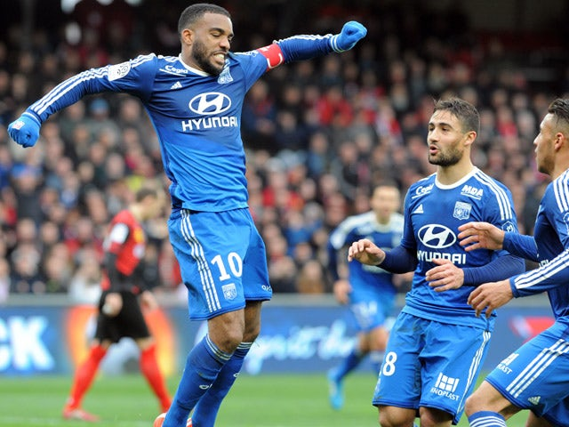 Lyon's French forward Alexandre Lacazette jubilates after scoring during the French L1 football match between Guingamp and Lyon on April 4, 2015