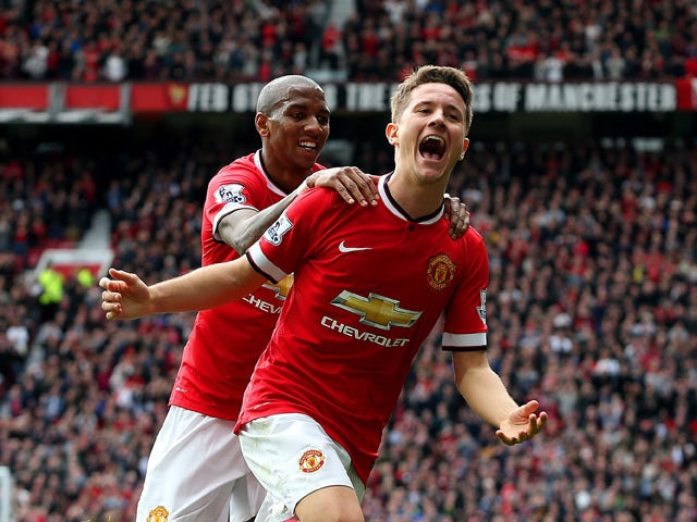 Ander Herrera of Manchester United celebrates with team-mate Ashley Young of Manchester United after scoring the opening goal during the Barclays Premier League match between Manchester United and Aston Villa at Old Trafford on April 4, 2015