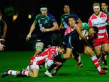 Connacht full back Mils Muliaina is stopped by Jonny May (l) and James Hook of Gloucester during the European Rugby Challenge Cup Quarter Final match between Gloucester Rugby and Connacht Rugby at Kingsholm Stadium on April 3, 2015