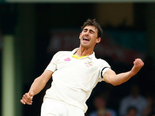 Mitchel Starc of Australia celebrates after taking the wicket of Suresh Raina of India during day five of the Fourth Test match between Australia and India at Sydney Cricket Ground on January 10, 2015