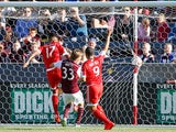 Juan Agudelo #17 of New England Revolution puts the ball in the back of the net for a goal in the 18th minute against Jared Watts #33 of Colorado Rapids as Charlie Davies #9 of New England Revolution celebrates to take a 1-0 lead against the Colorado Rapi