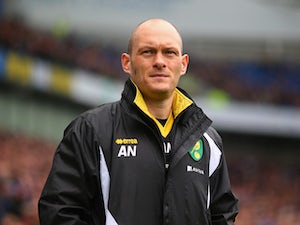 Manager Alex Neil of Norwich looks on during the Sky Bet Championship match between Brighton & Hove Albion and Norwich City at Amex Stadium on April 3, 2015