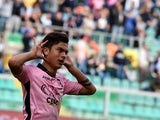 Paulo Dybala of Palermo celebrates after scoring a penalty (1-1) during the Serie A match between US Citta di Palermo and AC Milan at Stadio Renzo Barbera on April 4, 2015