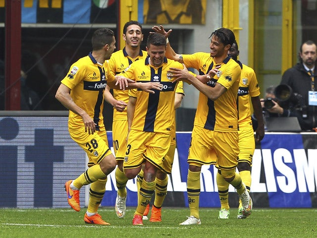 Andi Lila of Parma FC celebrates his goal with his team-mates during the Serie A match between FC Internazionale Milano and Parma FC at Stadio Giuseppe Meazza on April 4, 2015