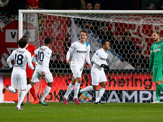 Luuk de Jong of PSV celebrates with team mates after he scores the first goal of the game during the Dutch Eredivisie match between FC Twente and PSV Eindhoven held at De Grolsch Veste Stadium on April 4, 2015