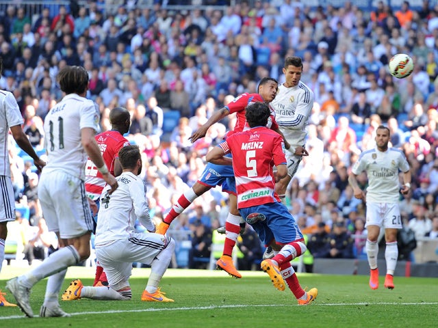 Cristiano Ronaldo of Real Madrid CF scores his team's 9th goal during the La Liga match between Real Madrid CF and Granada CF at Estadio Santiago Bernabeu on April 5, 2015