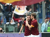 Roma's midfielder from Bosnia-Herzegovina Miralem Pjanic is congratulated by teammate Roma's forward from Serbia Adem Ljajic after scoring during the Italian Serie A football match between AS Roma and Napoli on April 04, 2015
