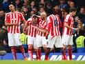 Charlie Adam of Stoke City celebrates with team-mates after scoring his team's first goal during the Barclays Premier League match between Chelsea and Stoke City at Stamford Bridge on April 4, 2015