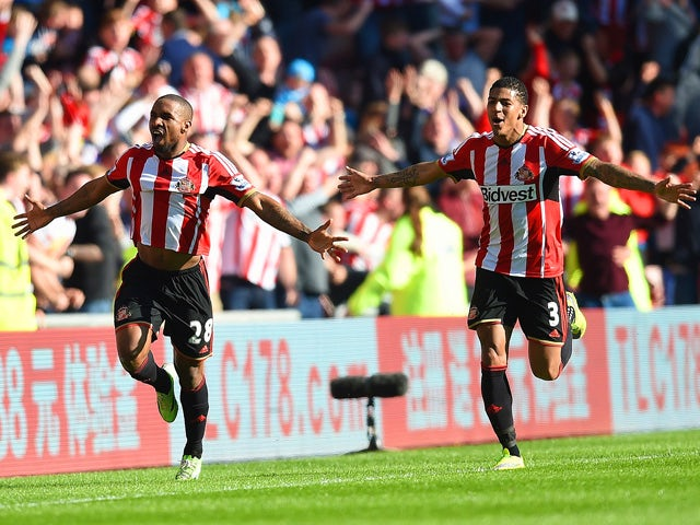 Jermain Defoe of Sunderland celebrates scoring the opening goal with Patrick van Aanholt of Sunderland during the Barclays Premier League match between Sunderland and Newcastle United at Stadium of Light on April 5, 2015