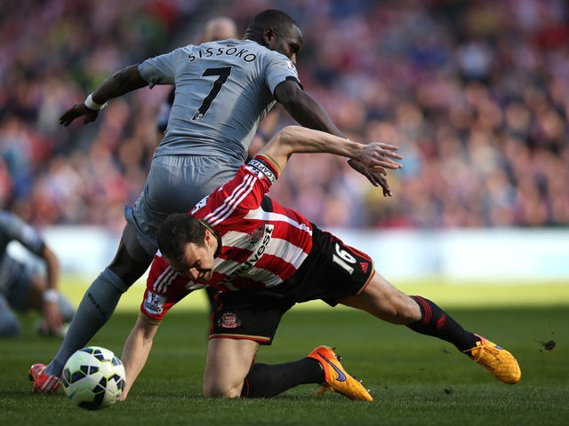Sunderland's Irish defender John O'Shea vies with Newcastle United's French midfielder Moussa Sissoko during the English Premier League football match between Sunderland and Newcastle United at The Stadium of Light in Sunderland, north east England on Apr
