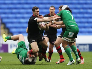 Tim Visser of Edinburgh is tackled by Eamonn Sheridan (L) and Blair Cowan of London Irish during the European Rugby Challenge Cup Quarter Final between London Irish and Edinburgh Rugby at Madejski Stadium on April 5, 2015