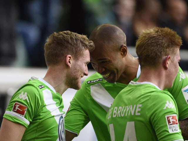 Wolfsburg's striker Andre Schurrle celebrates with his team-mates after scoring his first goal for his new side during the German first division Bundesliga football match VfL Wolfsburg vs VfB Stuttgart in Wolfsburg, northern Germany, on April 4, 2015