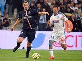Paris Saint-Germain's Swedish midfielder Zlatan Ibrahimovic (L) vies with Marseille's French defender Jeremy Morel during the French L1 football match between Marseille (OM) and Paris (PSG) on April 5, 2015