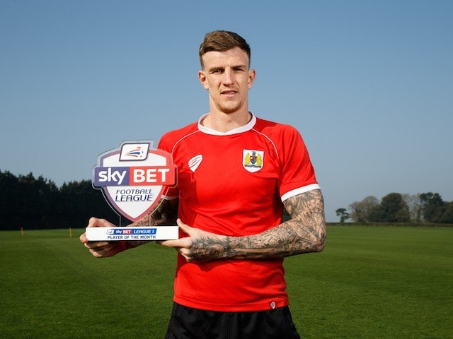 Bristol City's Aden Flint poses with his Player of the Month award for March 2015