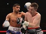 Amir Khan hits Paul McCloskey during the WBA Light-Welterweight Championship fight between Amir Khan and Paul McCloskey at MEN Arena on April 16, 2011
