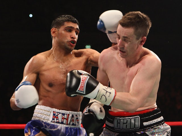Amir Khan hits Paul McCloskey during the WBA Light-Welterweight Championship fight between Amir Khan and Paul McCloskey at MEN Arena on April 16, 2011