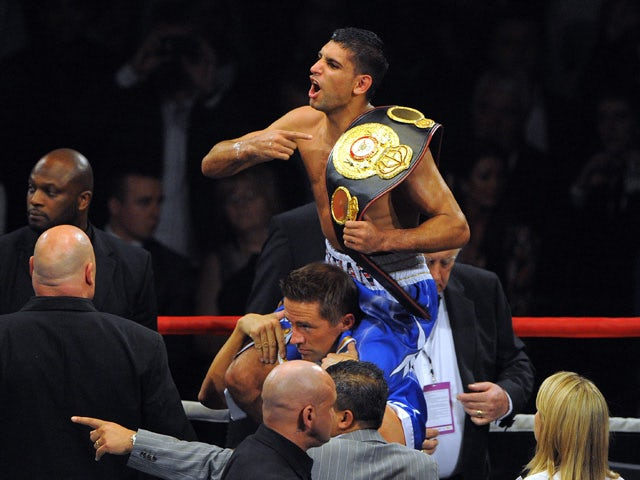 British boxer Amir Khan celebrates after defeating Northern Ireland's Paul McCloskey following their WBA Super Lightweight World Championship boxing fight at the MEN arena in Manchester, north-west England on April 16 2011