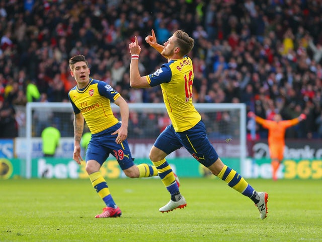 Aaron Ramsey of Arsenal celebrates scoring the opening goal with Hector Bellerin of Arsenal during the Barclays Premier League match between Burnley and Arsenal at Turf Moor on April 11, 2015