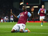 Christian Benteke of Aston Villa (20) celebrates as he scores their second goal during the Barclays Premier League match between Aston Villa and Queens Park Rangers at Villa Park on April 7, 2015