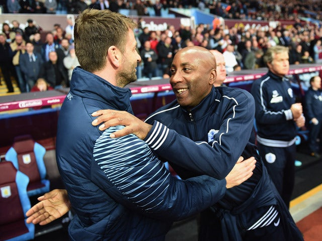 Tim Sherwood manager of Aston Villa and Chris Ramsey manager of QPR embrace prior to the Barclays Premier League match between Aston Villa and Queens Park Rangers at Villa Park on April 7, 2015
