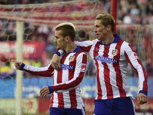 Atletico ease to win over Sociedad