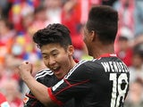 Heung Min Son celebrates scoring the 1-0 during the German first division Bundesliga football match between 1 FSV Mainz 05 v Bayer 04 Leverkusen in Mainz, Germany, on April 11, 2015