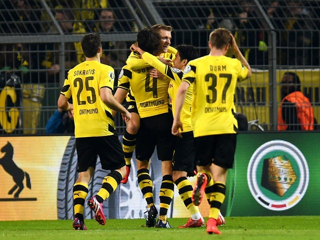 Dortmund's player celebrate during the German Football Cup DFB Pokal quarter-final match between Borussia Dortmund and 1899 Hoffenheim in Dortmund, western Germany, on April 7, 2015
