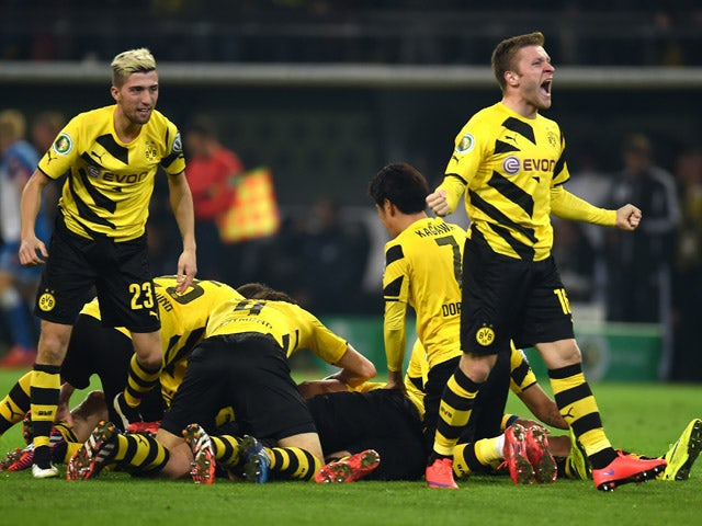 Dortmund's players celebrate during the German Football Cup DFB Pokal quarter-final match between Borussia Dortmund and 1899 Hoffenheim in Dortmund, western Germany, on April 7, 2015