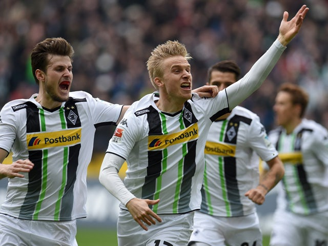 Monchengladbach's Swedish defender Oscar Wendt and his teammates celebrate after a goal during the German first division Bundesliga football match between Borussia Monchengladbach v Borussia Dortmund in Moenchengladbach, Germany, on April 11, 2015