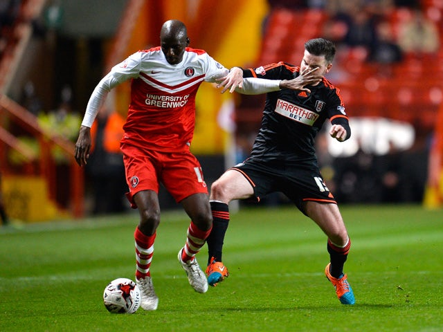 Alou Diarra of Charlton holds off Danny Guthrie of Fulham during the Sky Bet Championship match between Charlton Athletic and Fulham at The Valley on April 7, 2015