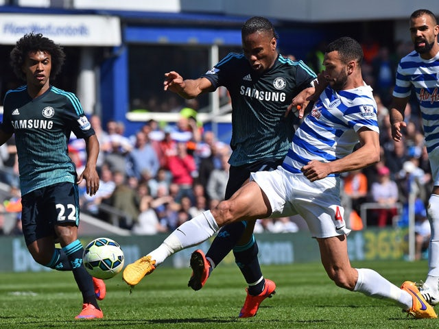 Chelsea's Ivorian striker Didier Drogba vies with Queens Park Rangers' English defender Steven Caulker during the English Premier League football match between Queens Park Rangers and Chelsea at Loftus Road Stadium in London on April 12, 2015