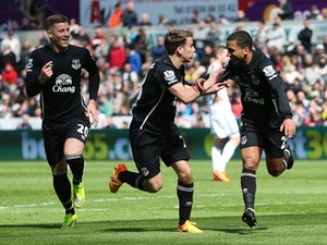 Aaron Lennon of Everton celebrates scoring the opening goal with Seamus Coleman and Ross Barkley of Everton during the Barclays Premier League match between Swansea City and Everton at Liberty Stadium on April 11, 2015