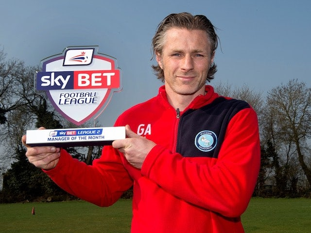 Wycombe Wanderers boss Gareth Ainsworth poses with his Manager of the Month award for March 2015