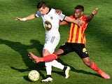 Lorient's French forward Giani Bruno (L) vies with Lens' French midfielder Wylan Cyprien during the French football match between Lens and Lorient on April 12, 2015