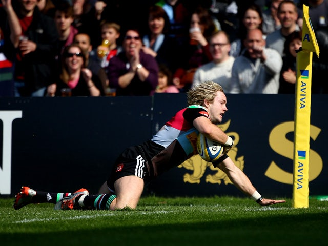 Charlie Walker of Harlequins goes over for the teams first try during the Aviva Premiership match between HarleHarlequins and Gloucester at Twickenham Stoop on April 11, 2015