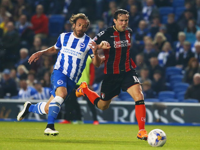 Inigo Calderon of Brighton & Hove Albion and Charlie Daniels of Bournemouth chase the ball during the Sky Bet Championship match on April 10, 2015