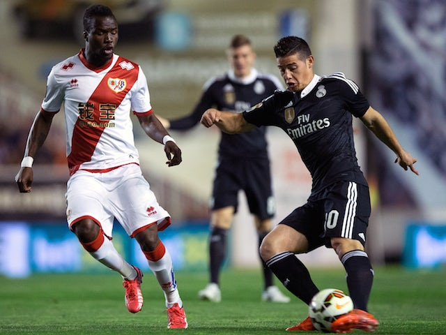 James Rodriguez (R) of Real Madrid CF competes for the ball with Mohammed Fatau (L) of Rayo Vallecano de Madrid during the La Liga match between Rayo Vallecano de Madrid and Real Madrid CF at Vallecas Stadium on April 8, 2015