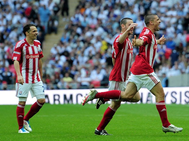Jonathan Walters (R) of Stoke celebrates with his team scoring the fourth goal during the FA Cup sponsored by E.ON semi final match between Bolton Wanderers and Stoke City at Wembley Stadium on April 17, 2011