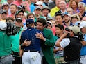 Masters winner Jordan Spieth is congratulated by 2014 champ Bubba Watson on April 12, 2015